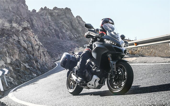 ducati in mountains - motorcycle touring style title
